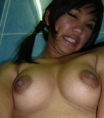 Busty Thai girl naked self shot shower pics