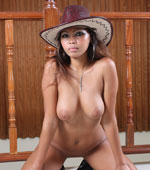 Filipina babe posing naked with cowboy hat
