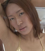 Tanned Japanese girl Nao has small tits