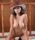 Filipina babe posing naked with cowboy hat