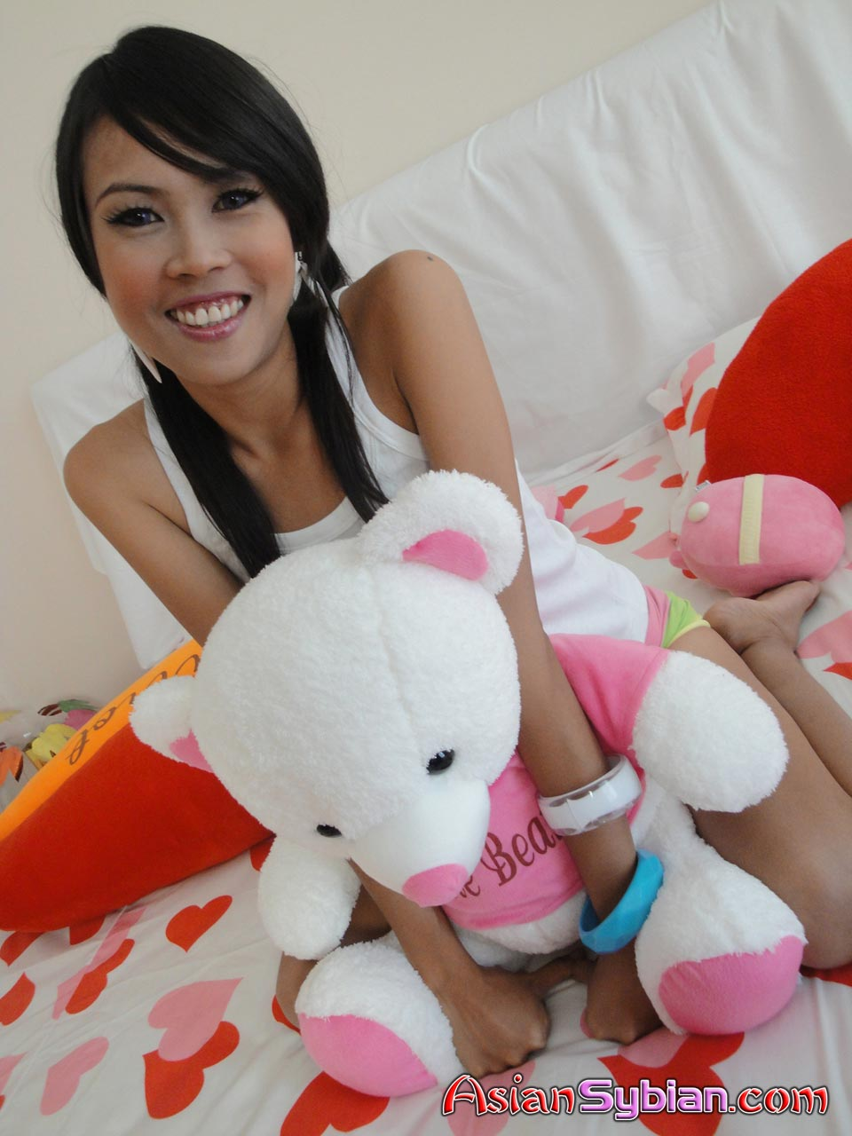 fuckable-asian-american-girl-swimming-breasts-video