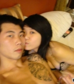 chinese-dude-with-tattoo-bonking-2-chicks-01